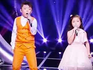 """Dos pequeños niños interpretan versión de """"You Raise Me Up"""""""