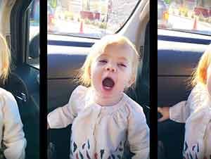 Bebé finge cantar como Adele.